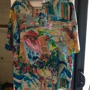 Looks like a hand painted blouse !